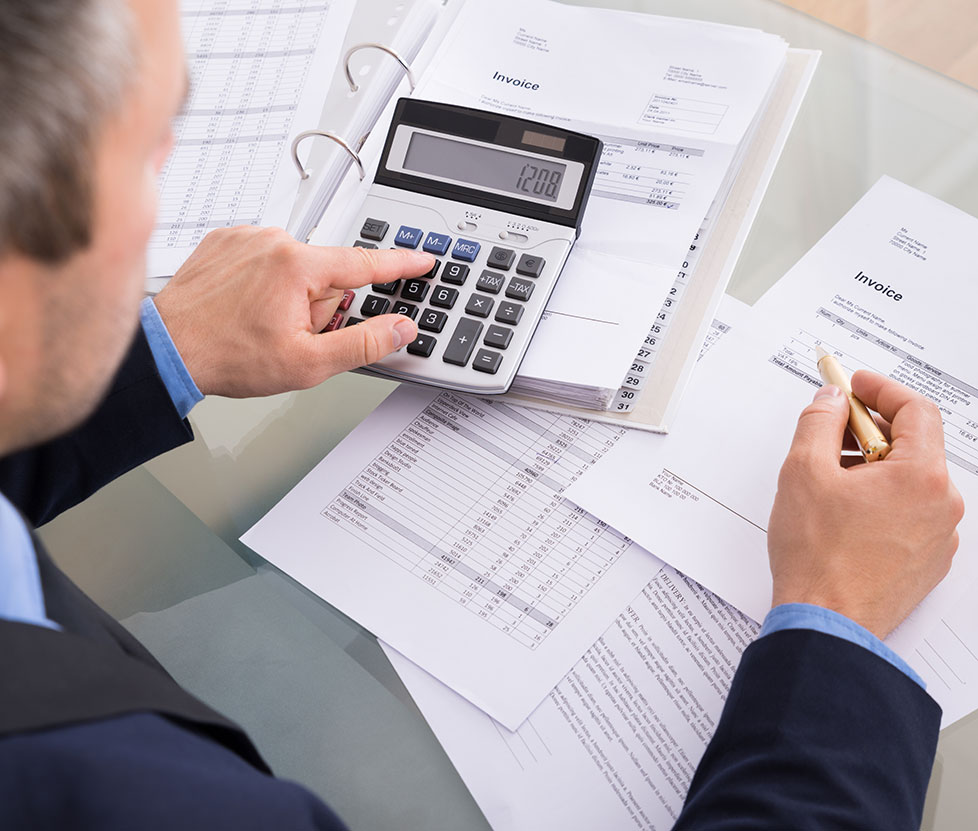 accountant with calculator and bills