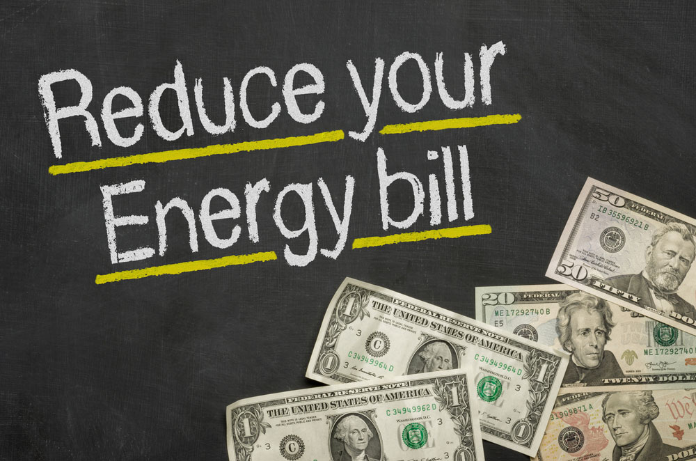 chalk writing of reduce your energy bill with dollar bills in right bottom corner